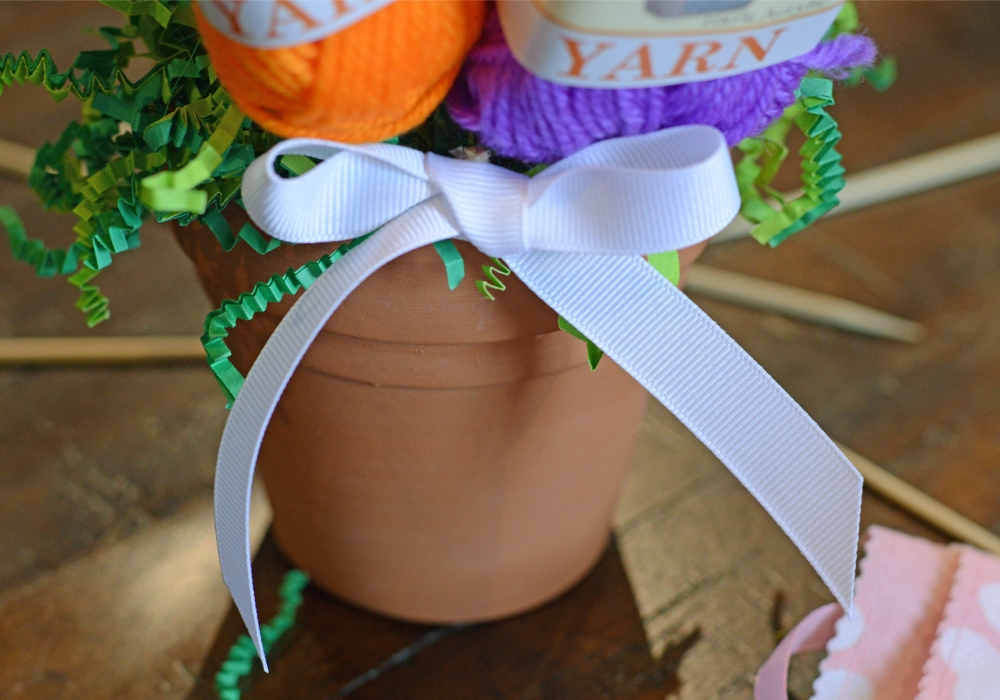 small white bow attached to a flower pot