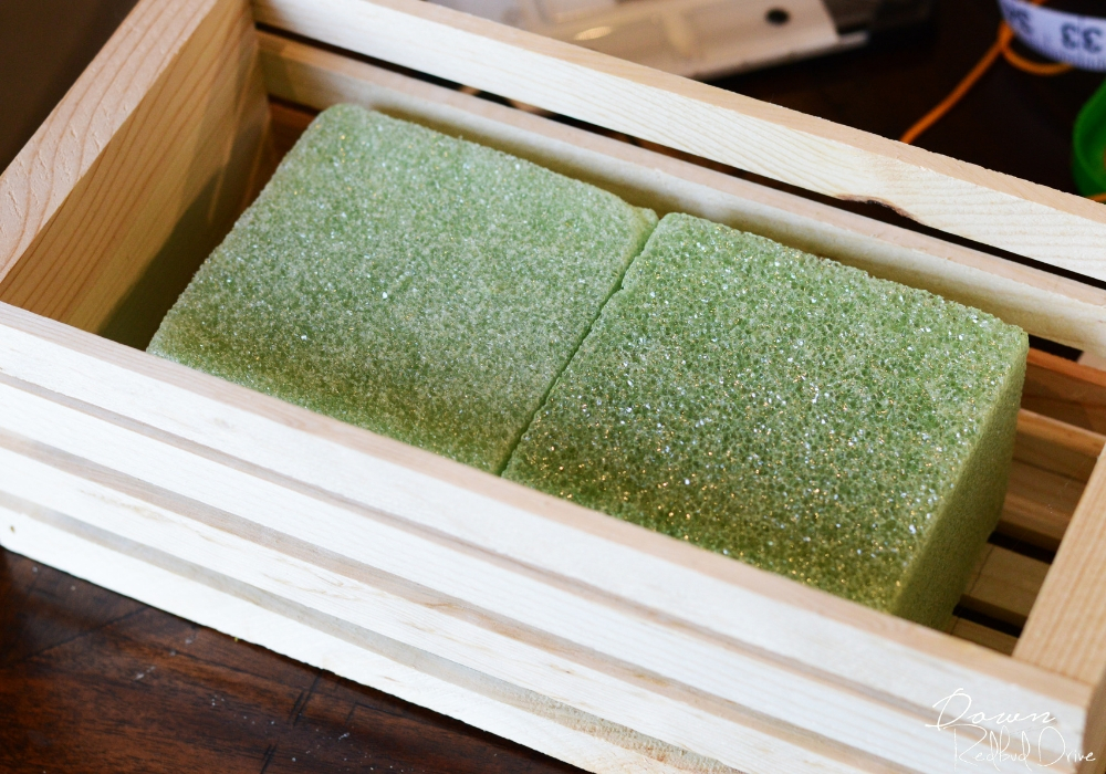 floral foam in a wooden crate
