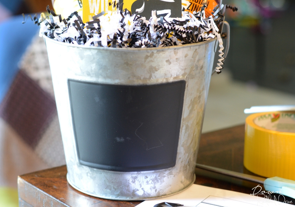 galvanized bucket with a chalk board label