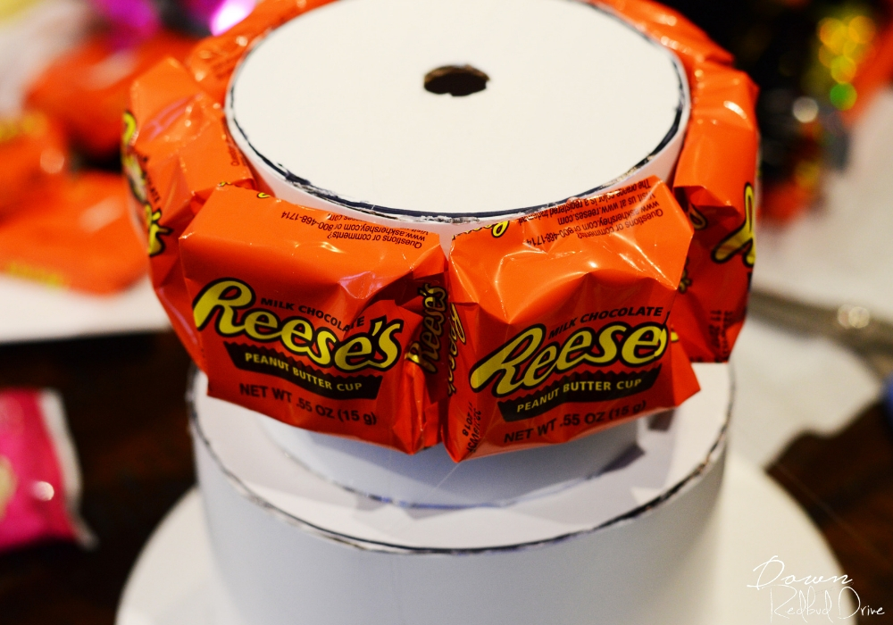 attaching Reese's to the money cake