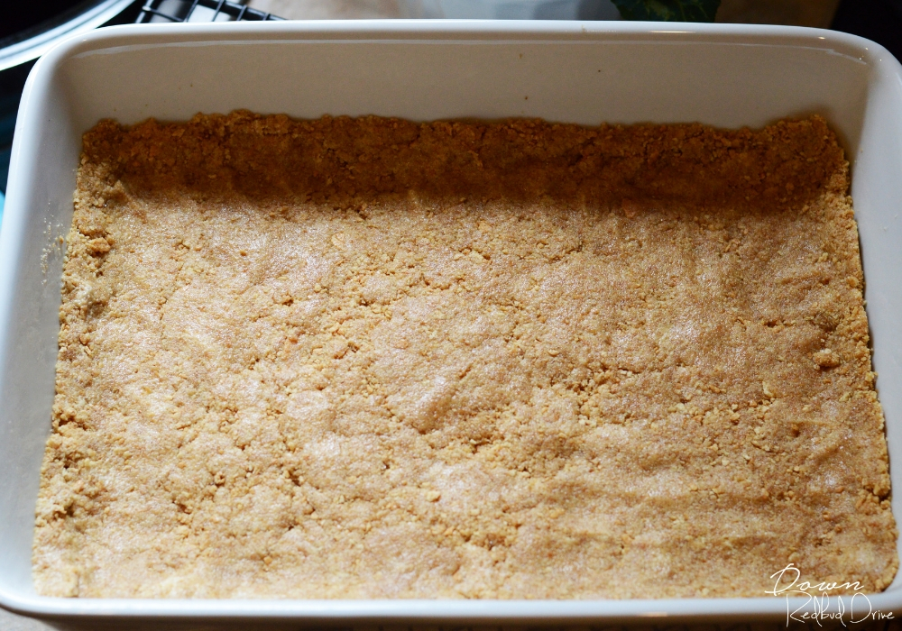 homemade graham cracker crust in a 9x13 pan