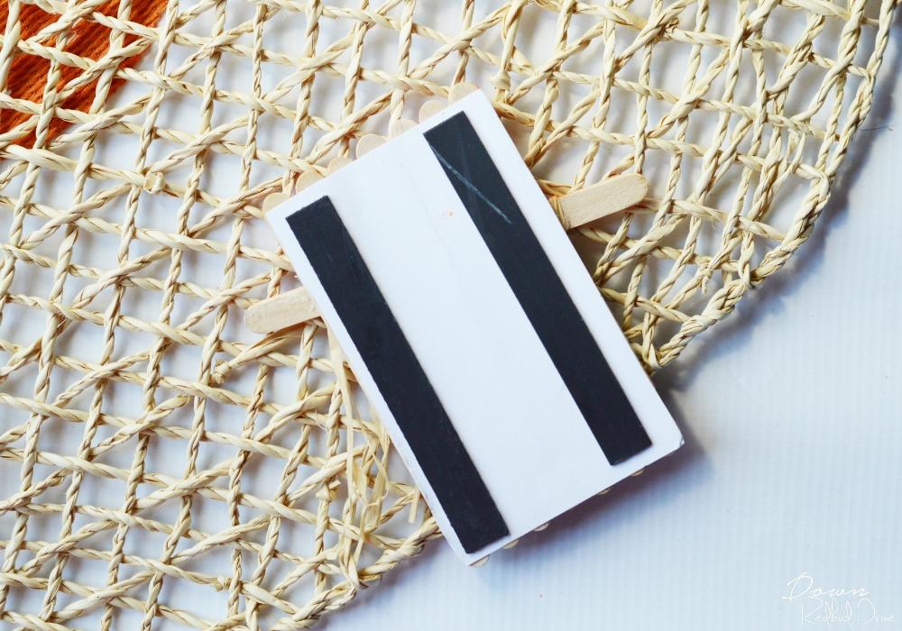 magnet strips glued onto popsicle sticks