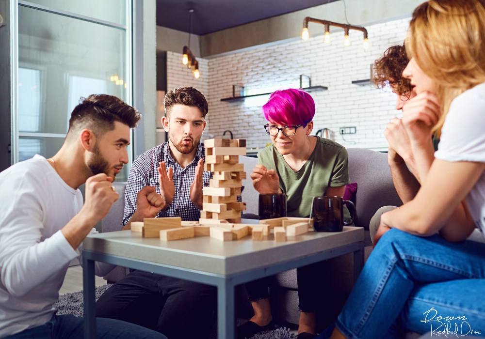 young adults playing Jenga