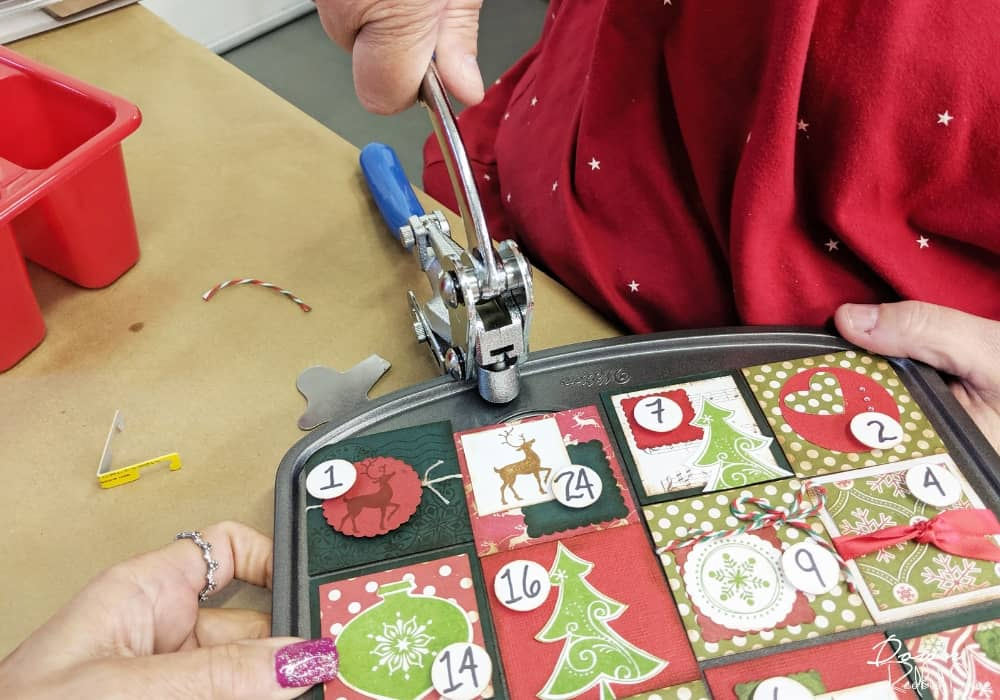 punching holes in a muffin tin advent calendar