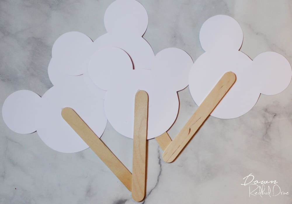 popsicle sticks glued to paper mickey heads