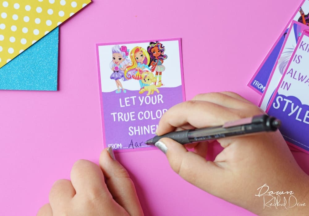 signing a name to printable sunny day valentines
