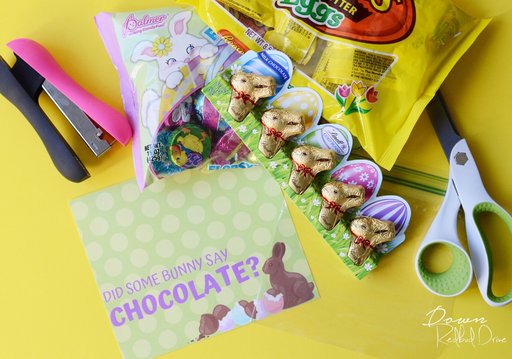 Did Some Bunny Say Chocolate label, scissors, a stapler, a sandwich baggie and Easter chocolate candy on a yellow background