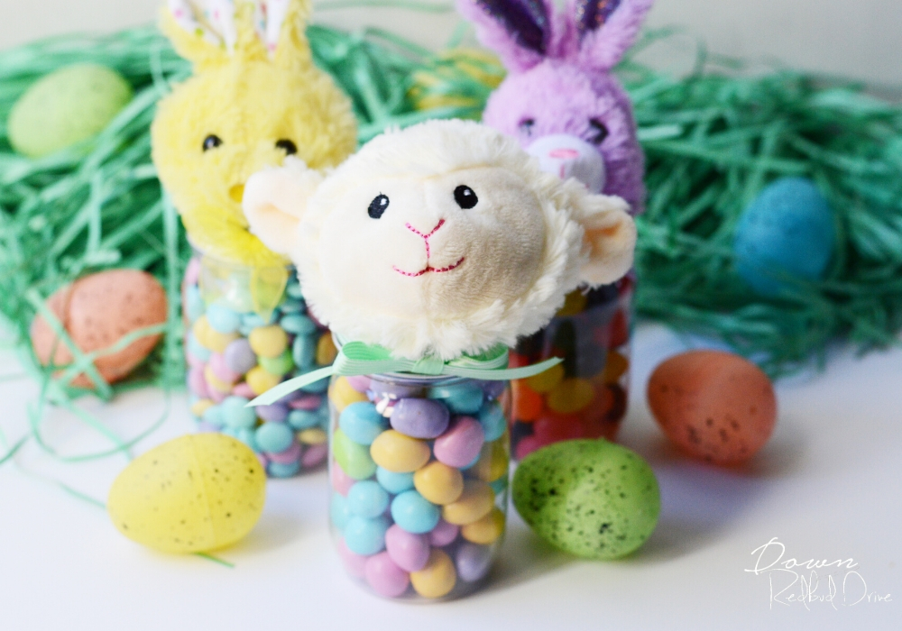 easter candy jars srrounded by easter grass and plastic easter eggs