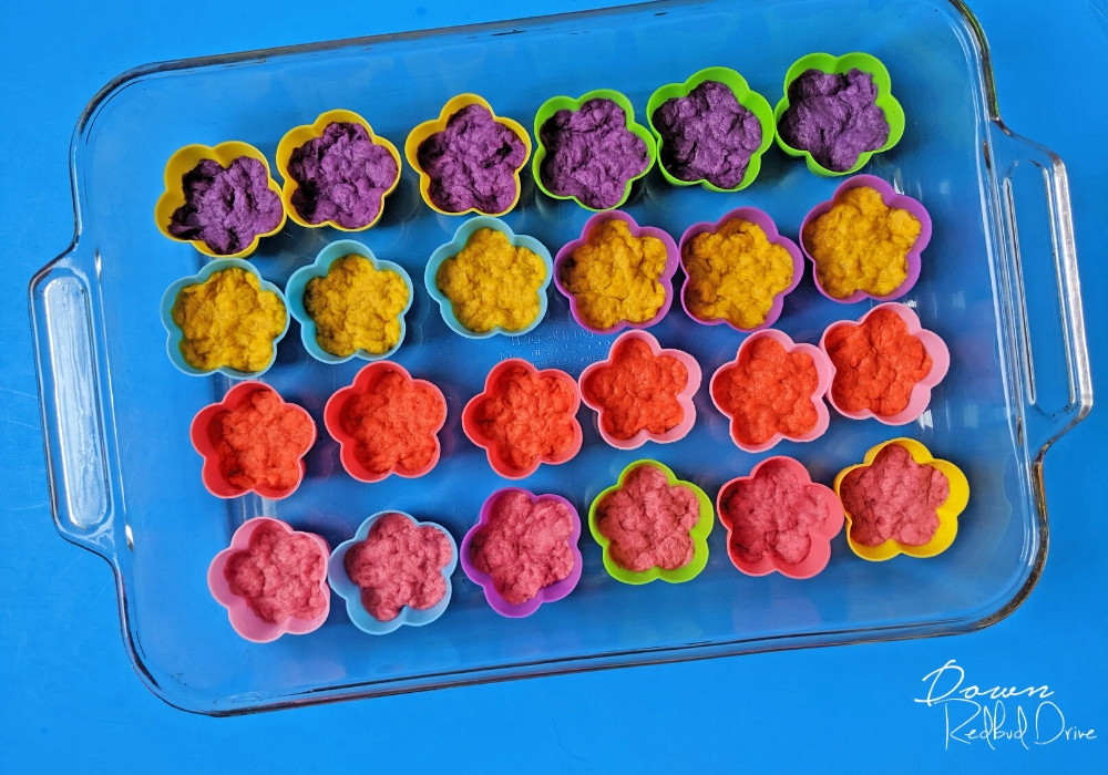 flower silicone molds halway full of wet paper pulp for seed bombs