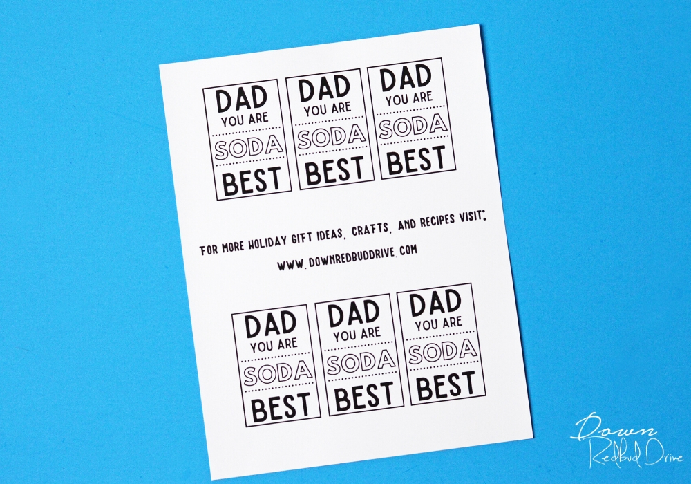 a printed sheet of father's day soda gift tags on a blue background