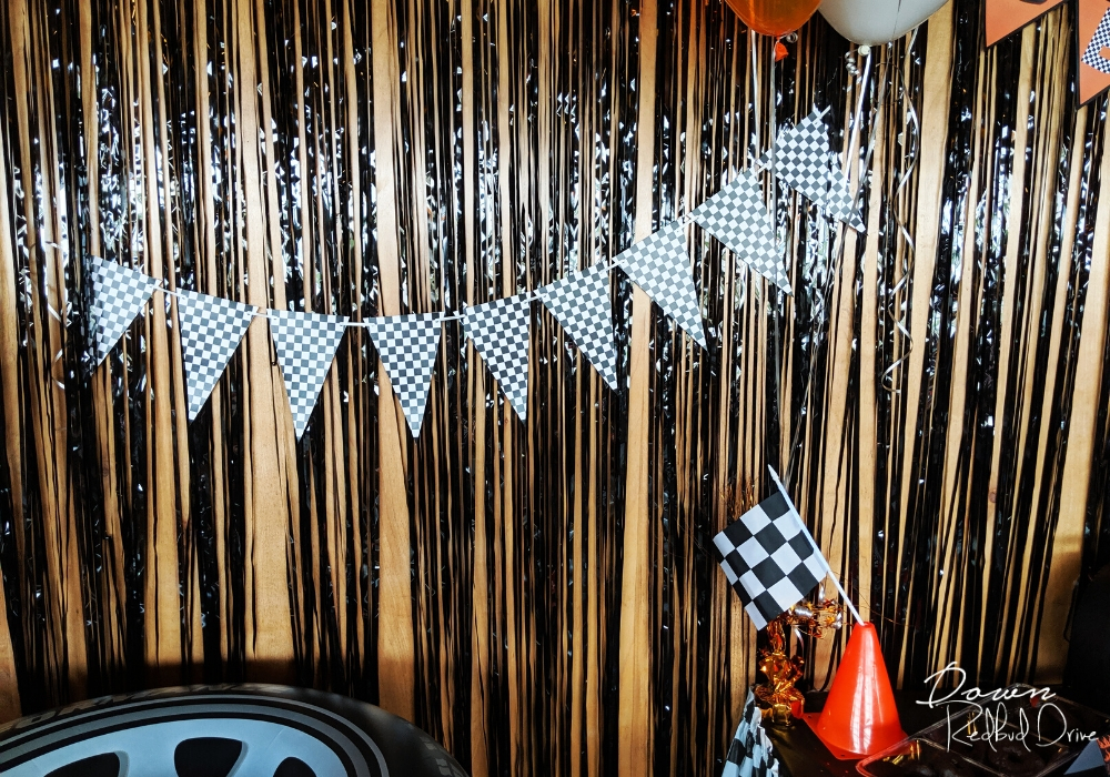 black and white checkered flag banner on a wall with black streamers
