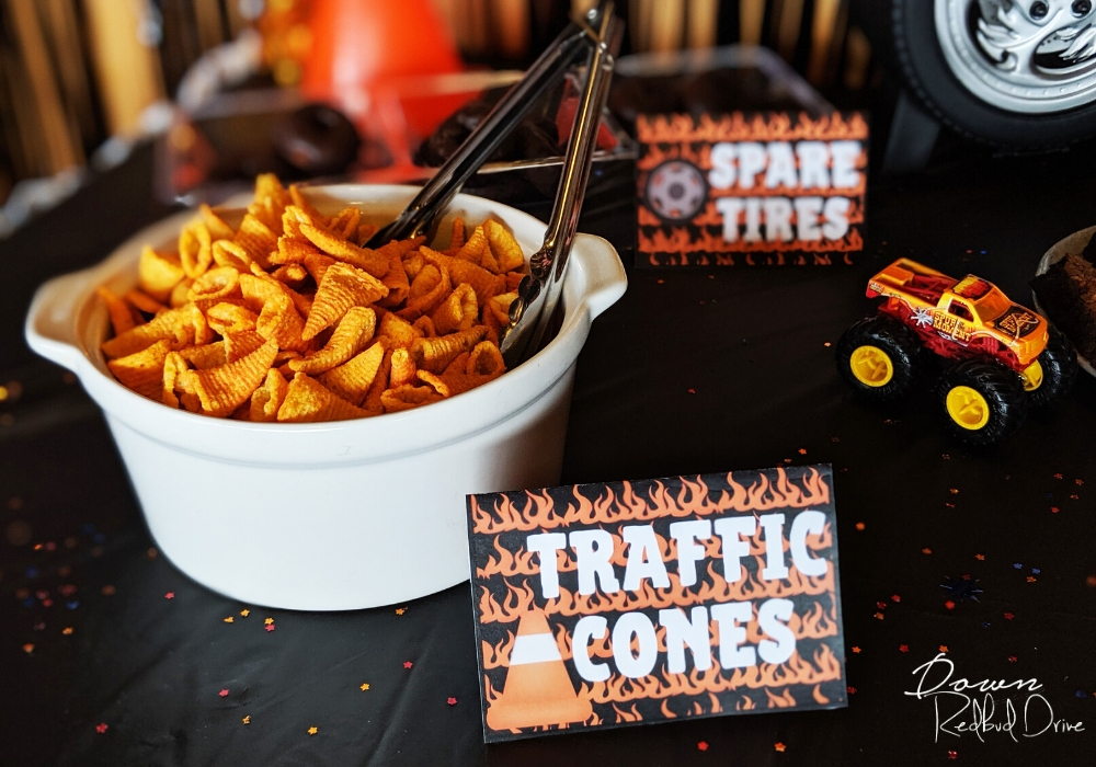 bugles in a white bowl on a black table with a sign that says traffic cones