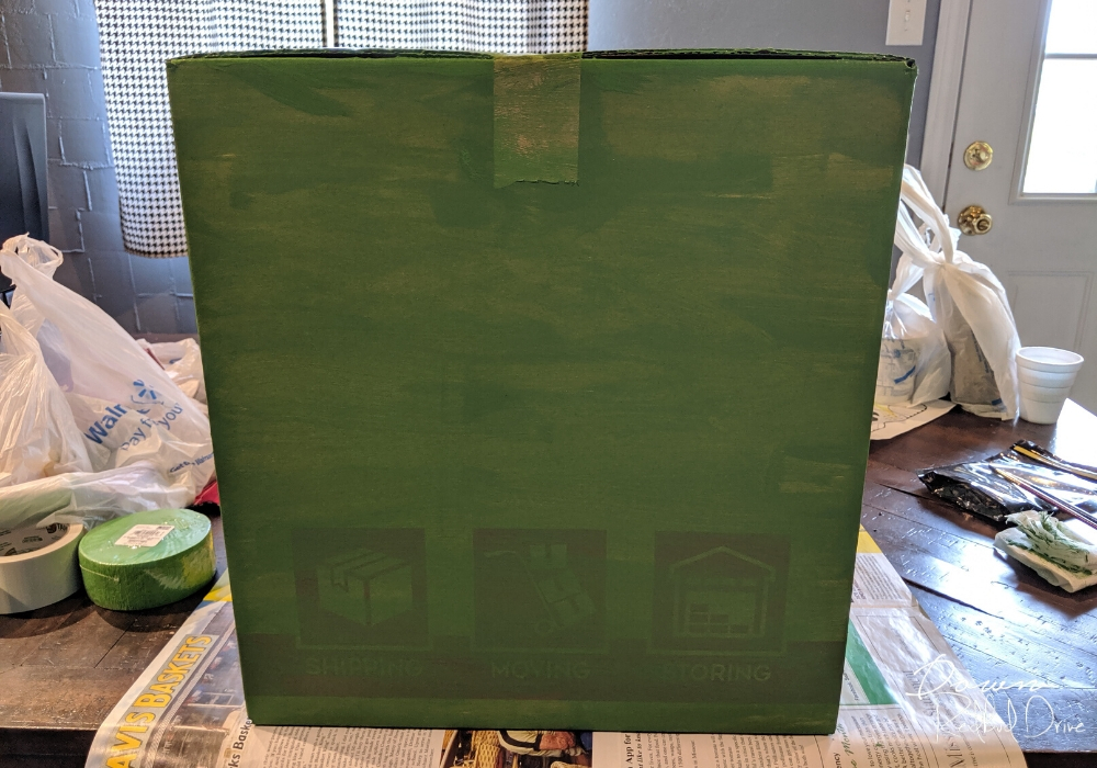 painted green box on a wooden table