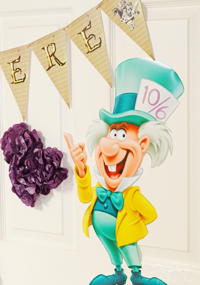 mad hatter wall cutout decor with an alice in wonderland birthday banner printable