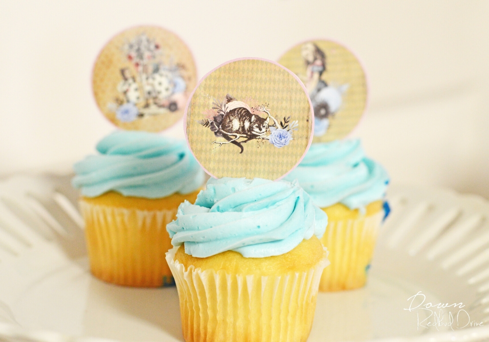 alice in wonderland cupcake toppers on blue frosted cupcakes