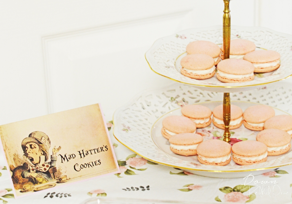 mad hatter's cookies card with a tiered tray of pink macarons