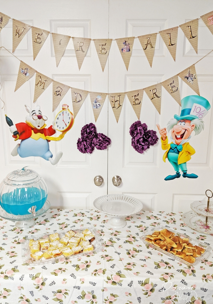 alice in wonderland birthday party main table with banner