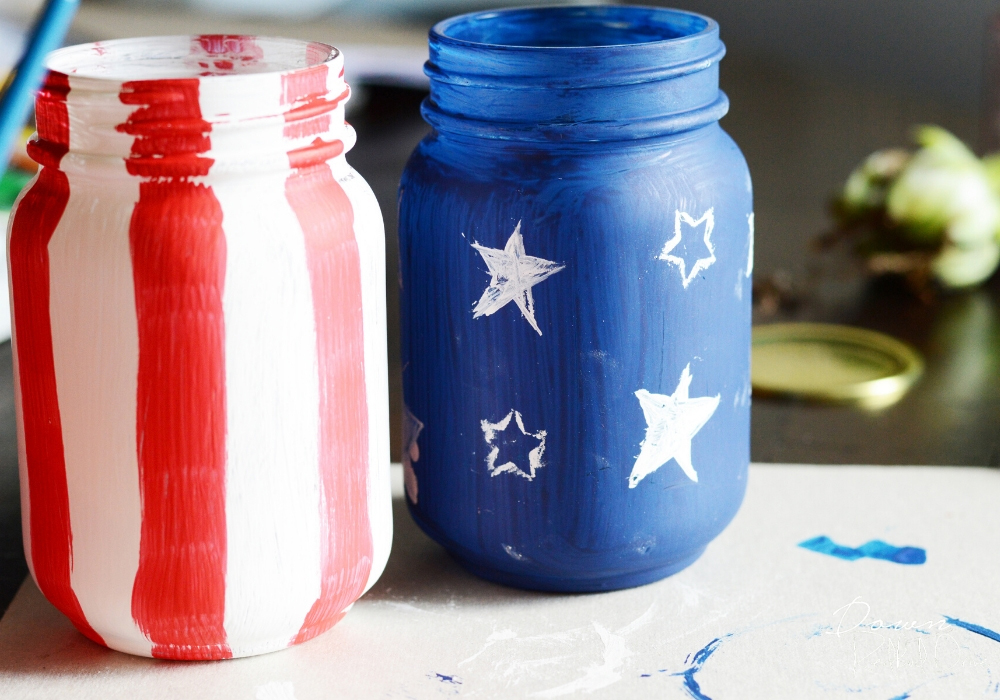 Painting the jars to make Patriotic Succulent Planters