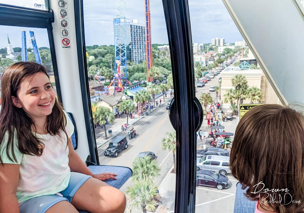 Kids riding on the Skywheel Myrtle Beach