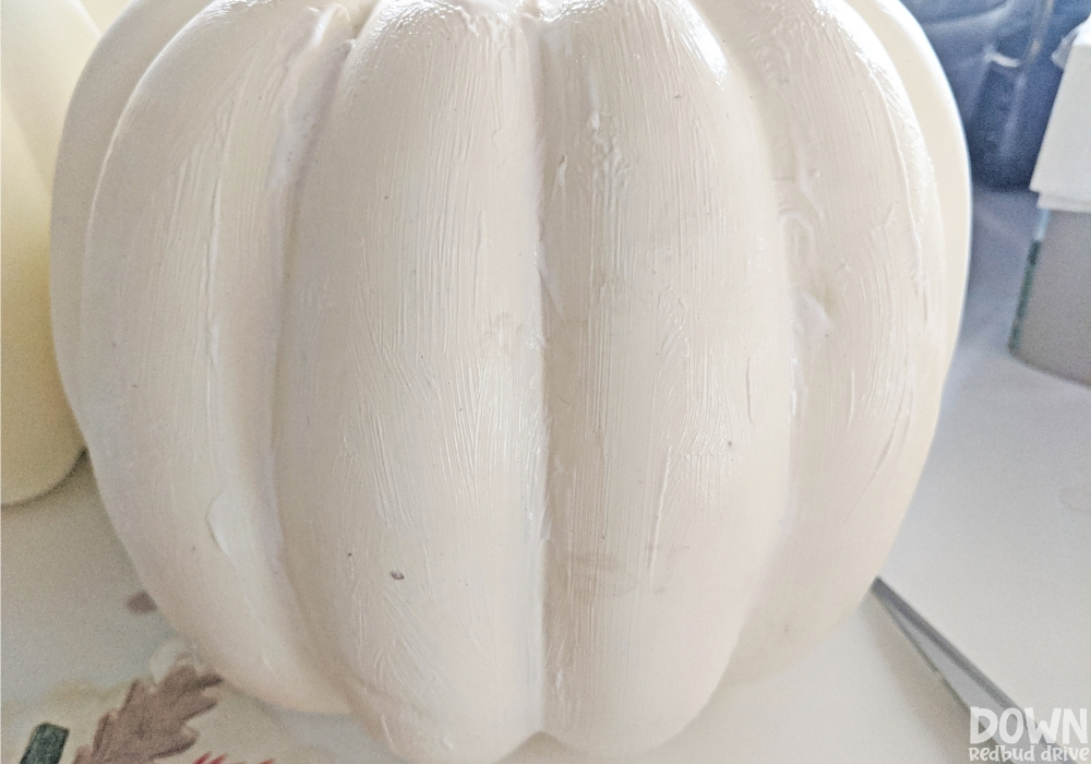 Picture of a decorative pumpkin covered in Mod Podge for the DIY Napkin Pumpkins.