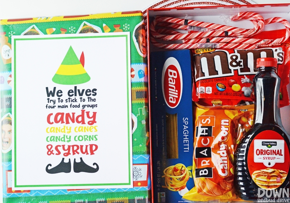 The gift box full of elf food with the elf printable on the lid.