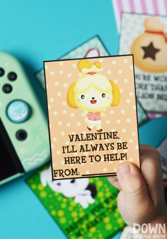 """A tall image of a child holding a valentine that says """"Valentine, I'll always be here to help!"""" on it."""