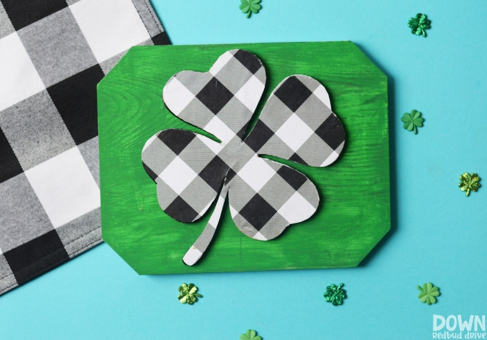 Overhead view of the finished DIY Buffalo Plaid Shamrock Sign