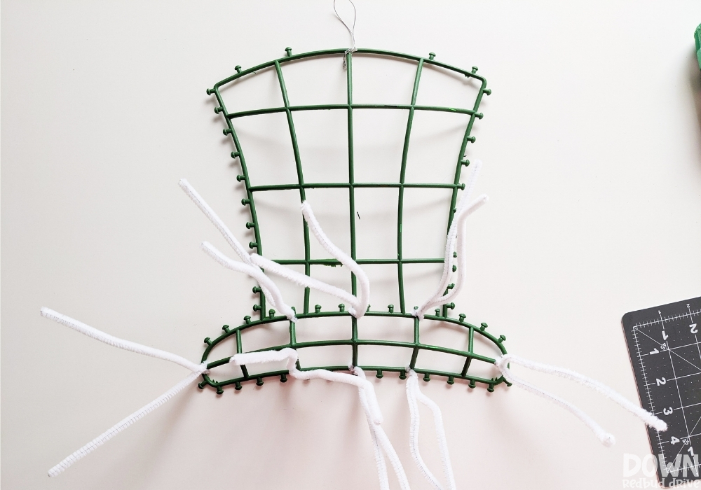 How to attach pipe cleaners to a wire wreath form for mesh wreaths.