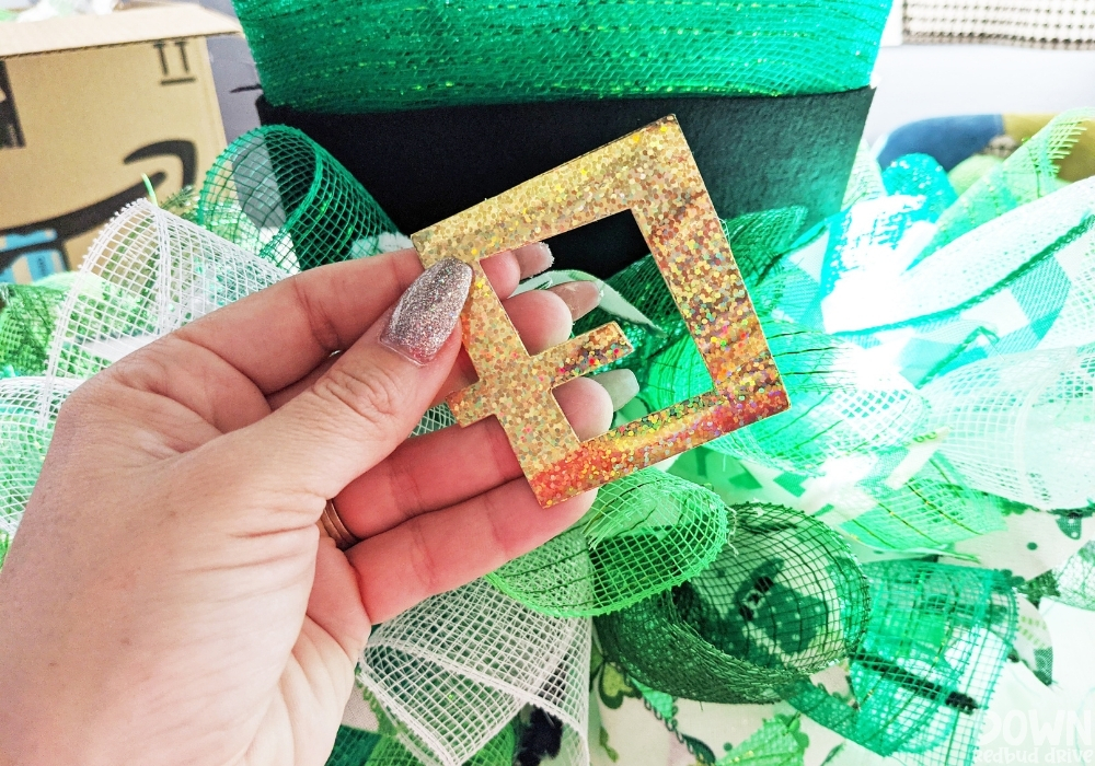 Gold hat buckle to attach to a hat wreath for St. Patrick's Day.
