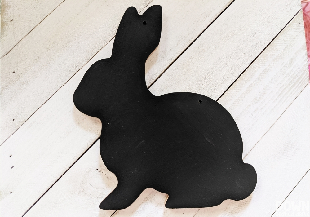 The black painted bunny decoration for the DIY Buffalo Plaid Easter Sign.