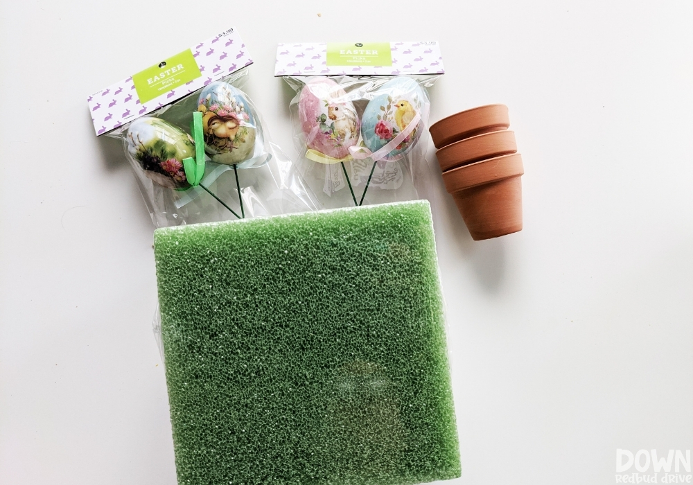 Overhead view of the supplies for the DIY Easter Egg Topiary.