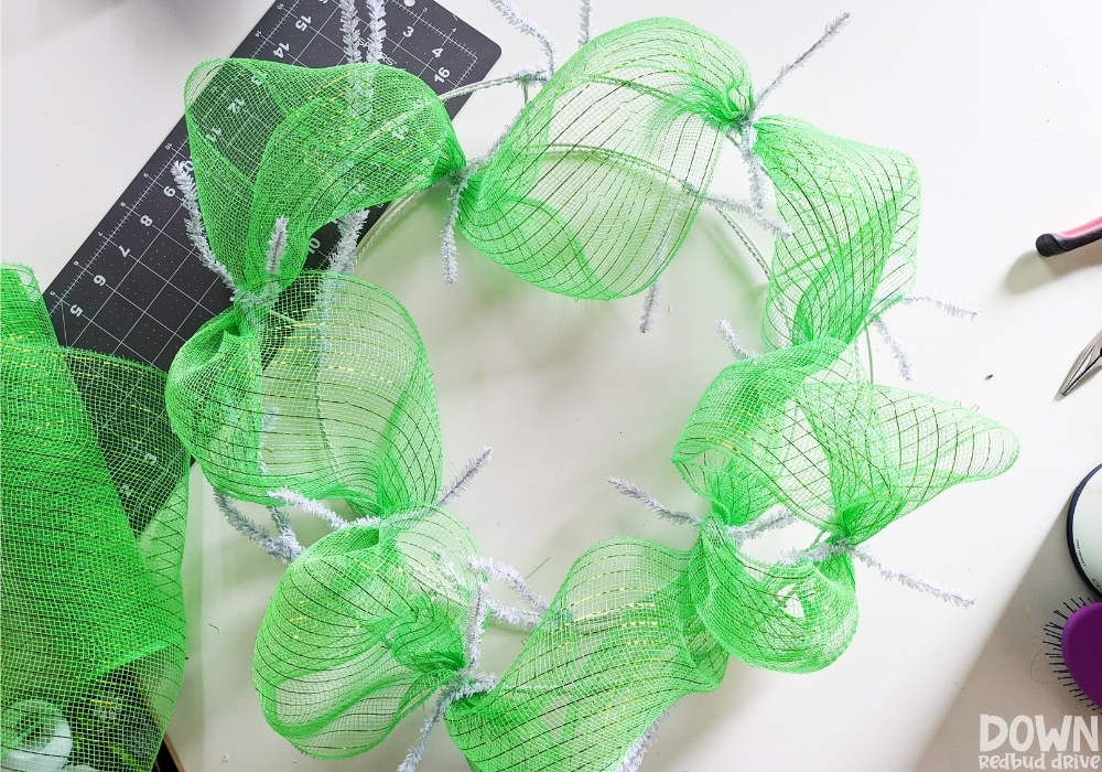 Closeup of the green mesh added to the wreath form.