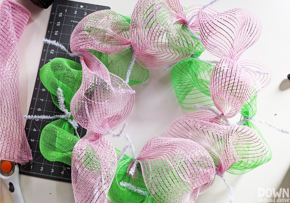 Closeup of the pink mesh added to the wreath form.