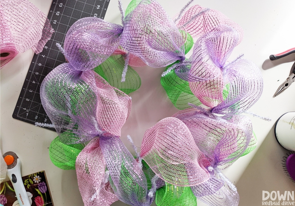 Closeup of the purple mesh added to the wreath form.