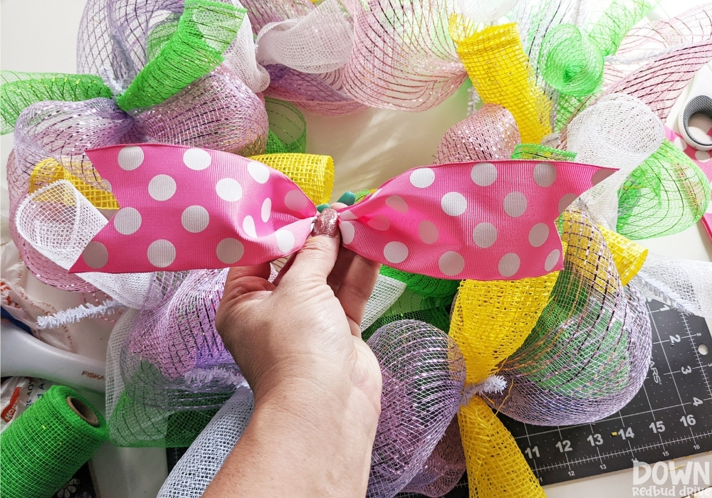 The pink polka dot bow for the DIY Easter mesh wreath.