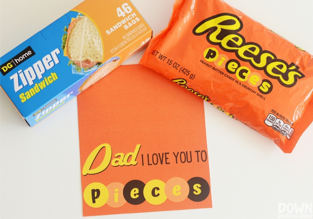 Overhead view of the supplies for the DIY Father's Day Reese's Pieces Gift.