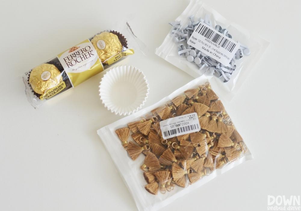 Overhead view of the supplies for the DIY Ferrero Rocher graduation treats.