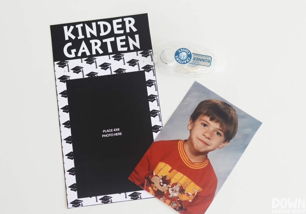 A kindergarten school picture and double sided tape next to a kindergarten printable photo frame.
