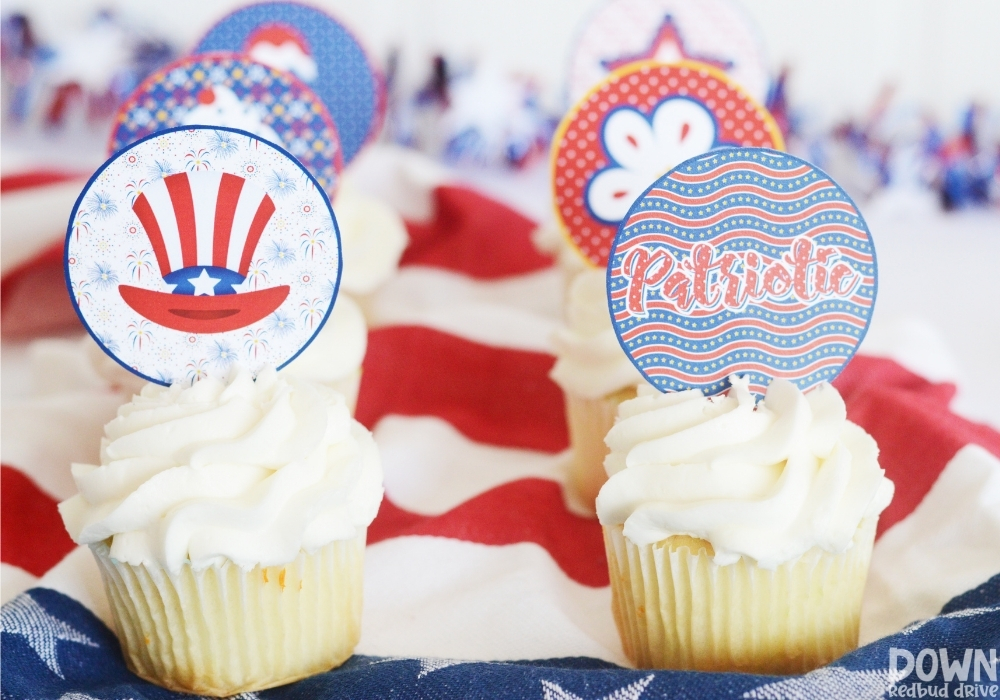 Cupcakes decorated with patriotic cupcake toppers.