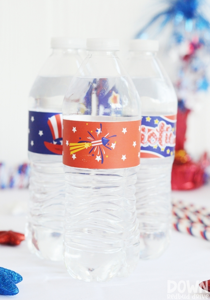 Tall close up of water bottles with patriotic labels on them.