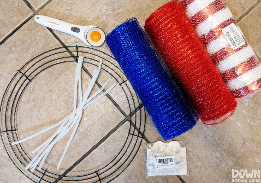 Overhead view of the supplies for the DIY American Flag Mesh Wreath.