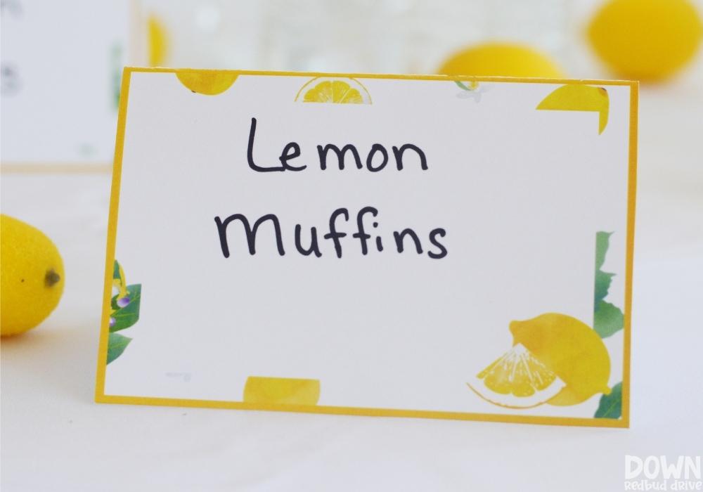 Close up of the DIY Lemon Baby Shower food cards.