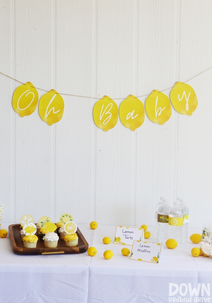 Tall picture of the decorations for the DIY Lemon Baby Shower.