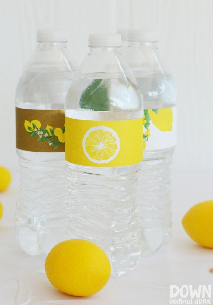 Close up tall image of the lemon themed water bottles.