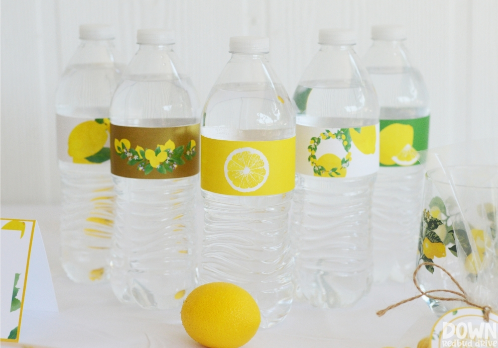 Wide close up of the lemon themed water bottle labels.