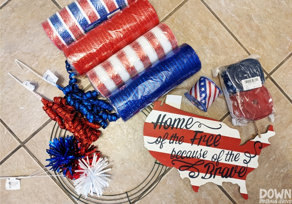 The supplies for the Patriotic Deco Mesh Wreath laid out.