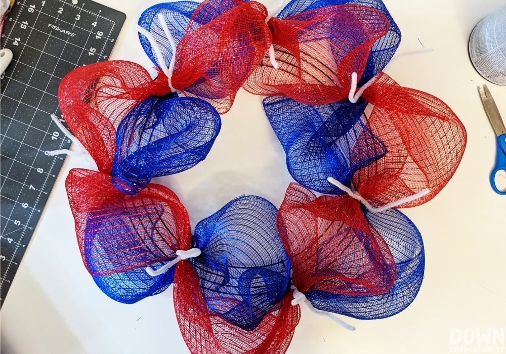 Red and white deco mesh attached to a wreath form for the Patriotic Deco Mesh Wreath.