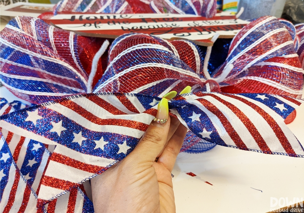 Close up of the patriotic ribbon that's going to be attached to the Patriotic Deco Mesh Wreath.