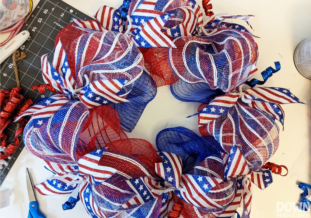 The Patriotic Deco Mesh Wreath with all the ribbon attached to it.