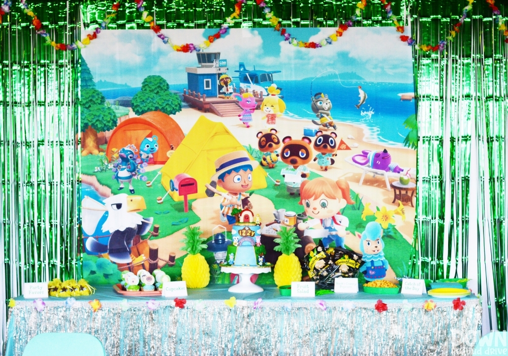 Closeup of a party food table and Animal Crossing backdrop for the Animal Crossing Birthday Party.